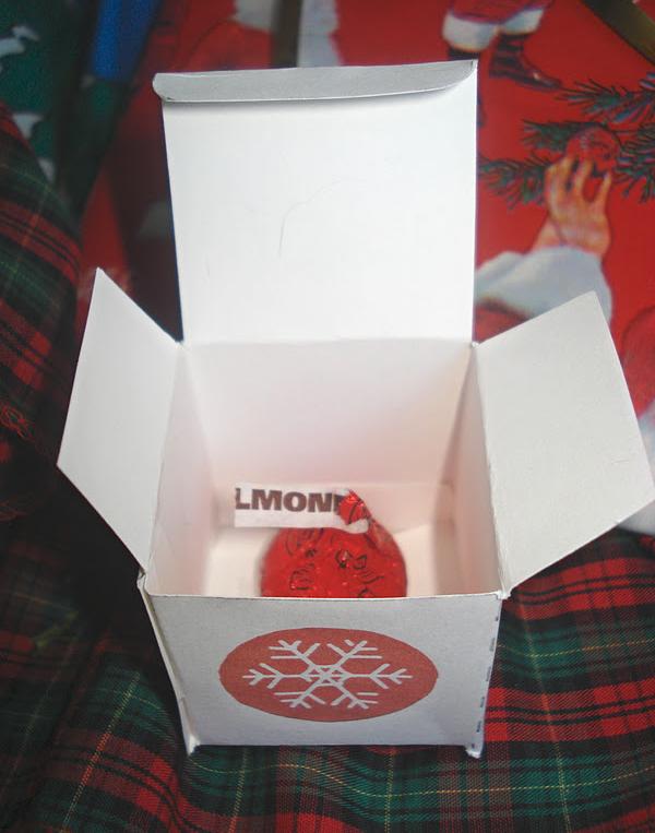 """An elf-sized """"kiss"""" box."""