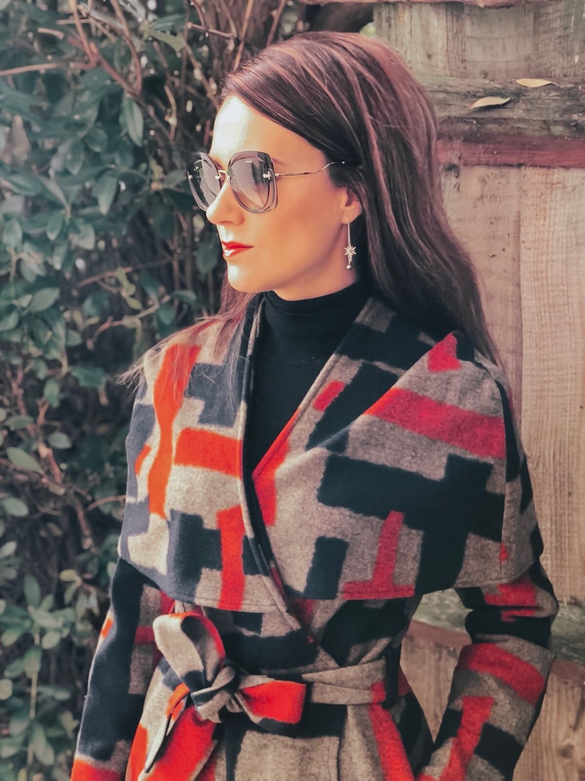 Lavish Alice cape overlay wool coat in abstract print | Faith Buckle Detail Stiletto Boots | Miu Miu Sunglasses | Valentino Red Tote Daybags | Swarovski FANTASTIC CHAIN PIERCED EARRINGS, WHITE | Faith Buckle Detail Stiletto Boot | Replay Luz Mid Rise Rinse Jeans with Contrast Stitch