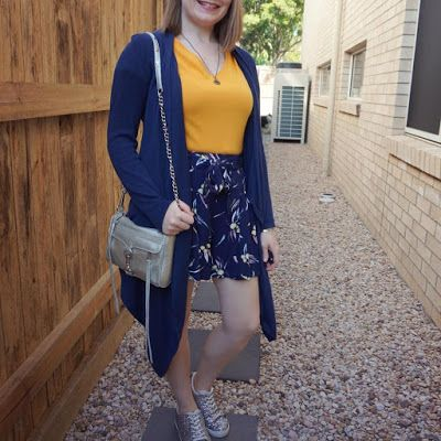 awayfromblue Instagram | navy waterfall cardigan with mustard tee and printed shorts blue and yellow SAHM style outfit with silver accessories