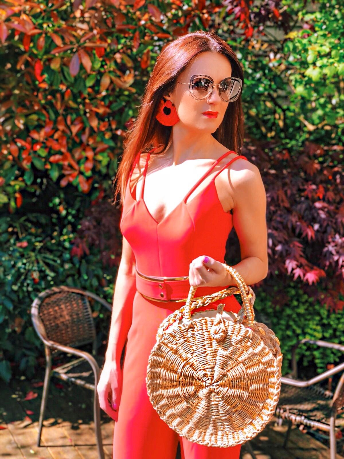 BROOKE - BRIGHT CORAL DOUBLE STRAP JUMPSUIT WITH GOLD WAISTBAND | South Beach Round Gold Woven Straw Cross Body Bag | Elegant Duchess Boutique Bohemian earrings