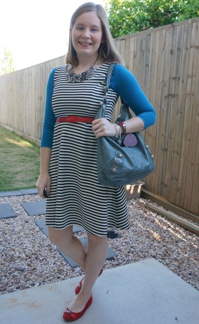 teal tee under striped fit and flare sleeveless dress with red accessories and balenciaga day bag   away from blue