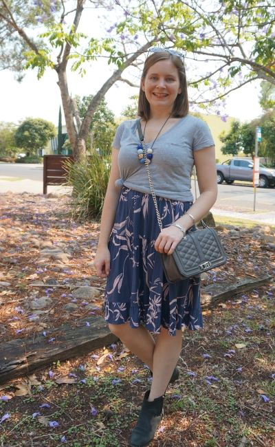 grey v neck tee knotted over printed tiered sundress with ankle boots love bag | away from blue