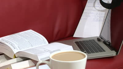 stock-footage-tracking-shot-of-laptop-cup-of-coffee-and-study-books.jpg