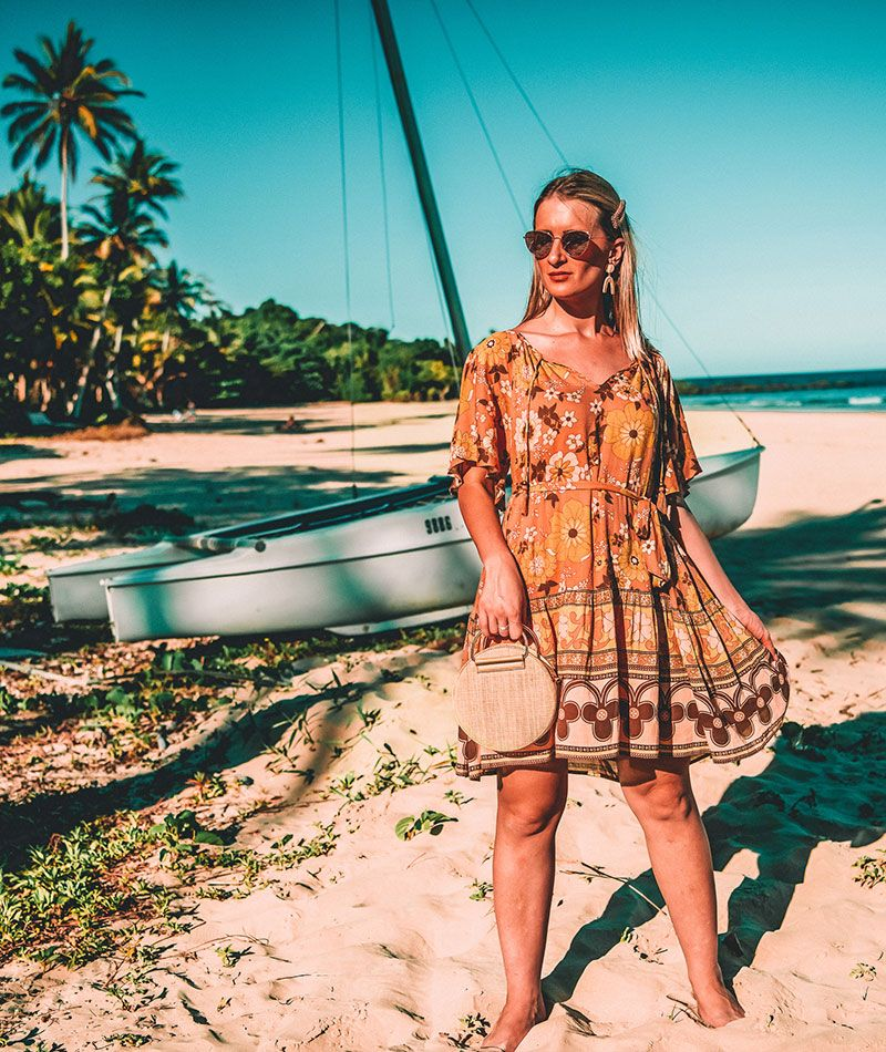 spell buttercup mini dress outfit by the daily luxe on tropical beach