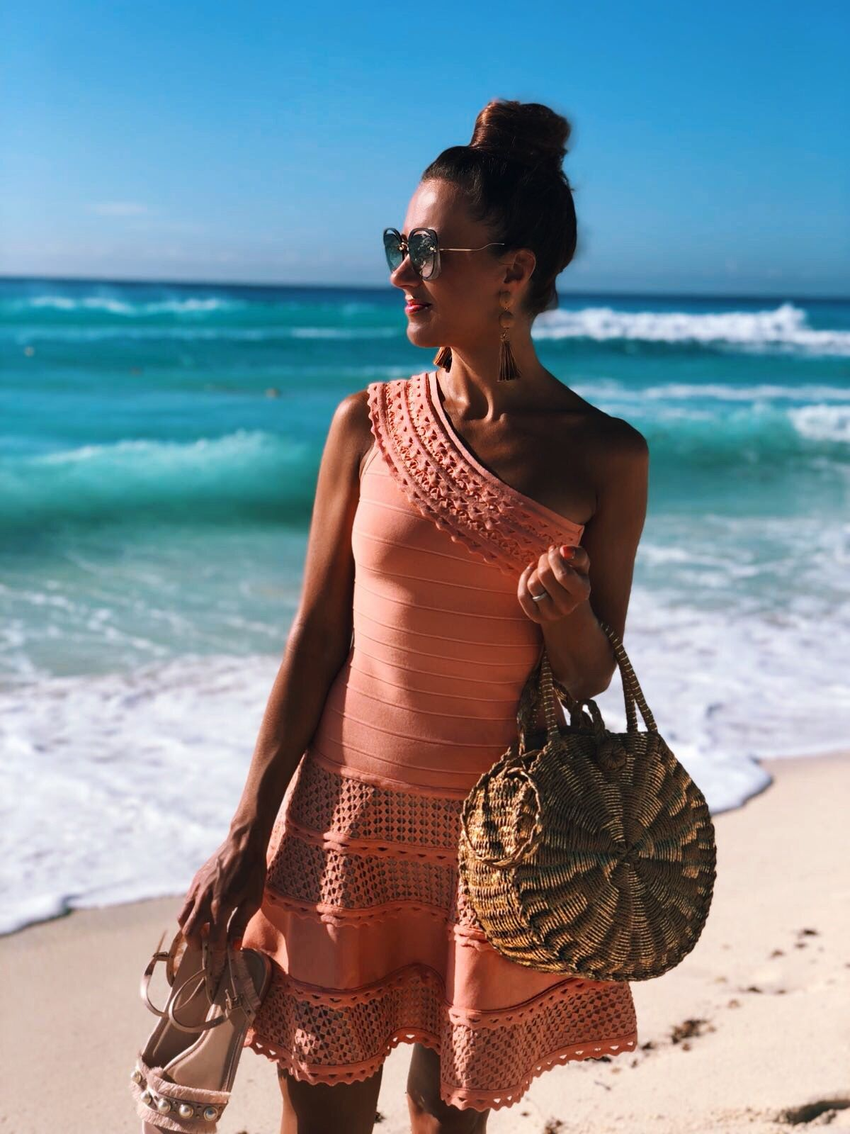 Cancun Mexico | Secrets the Vine hotel Forever Unique Structured One Shoulder Skater Dress With Lace Inserts | Glamorous Pearl Embellished Satin Sandals | Swarovski hoop earrings | Miu Miu sunglasses | ASOS DESIGN Wrapped Bead & Tassel Earrings | South Beach Round Gold Woven Straw Cross Body Bag