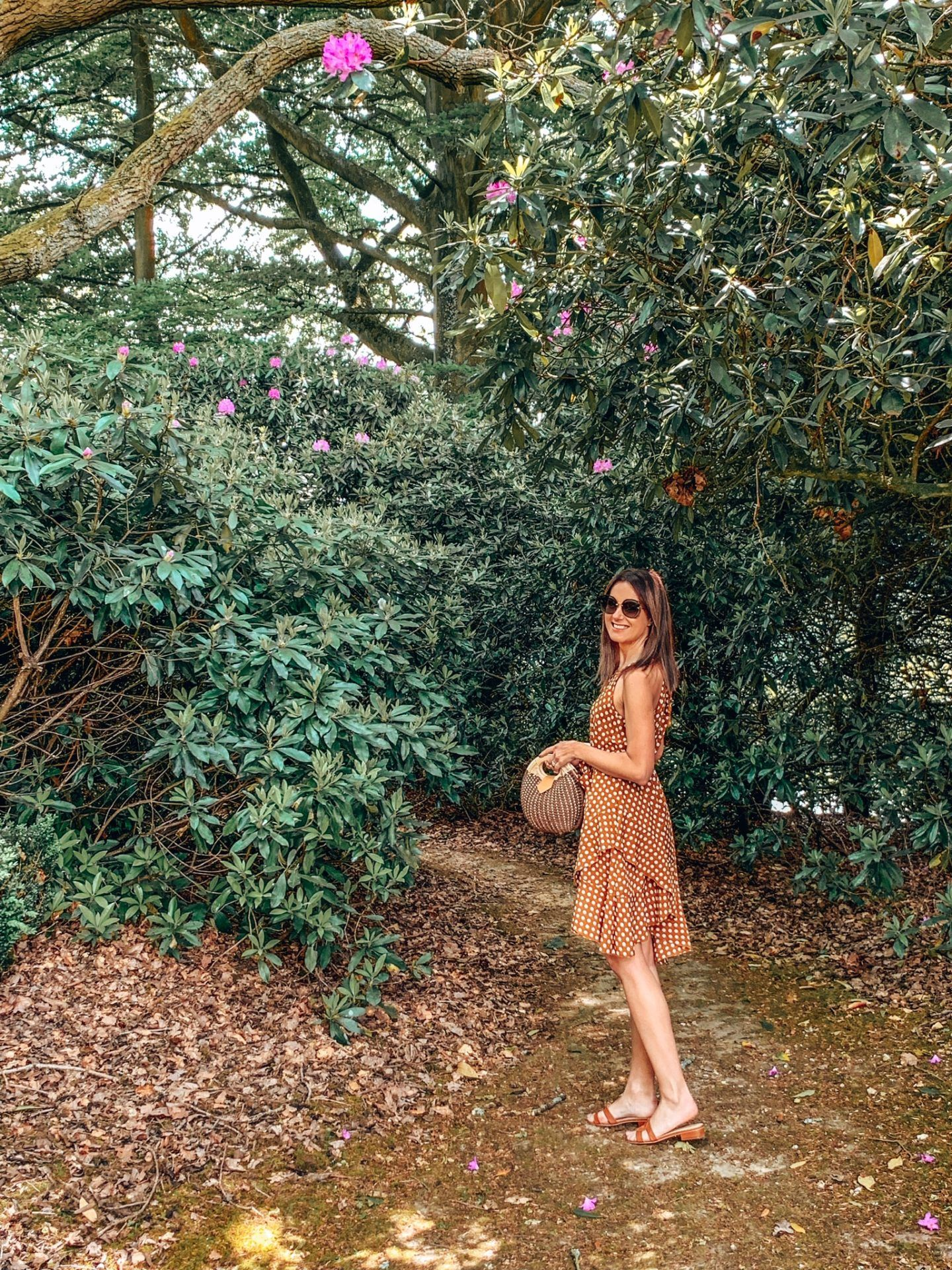 Alexander House | Luxury Five Star Hotel & Spa in West Sussex | Elegant Duchess Boutique Polka Dot dress and a straw bag