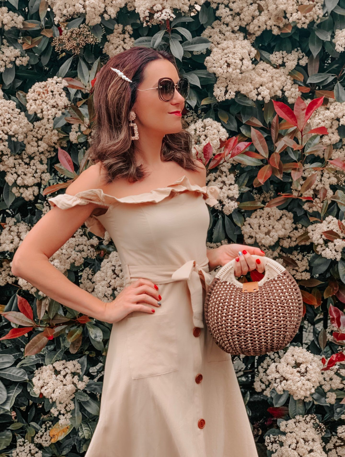 OUTFIT FROM ELEGANT DUCHESS BOUTIQUE Round Summer Beach Straw Bag | Off shoulder ruffle detail midi dress | TEXTURED GEOMETRIC EARRINGS | Pearl Hair Clip | MIU MIU SUNGLASSES