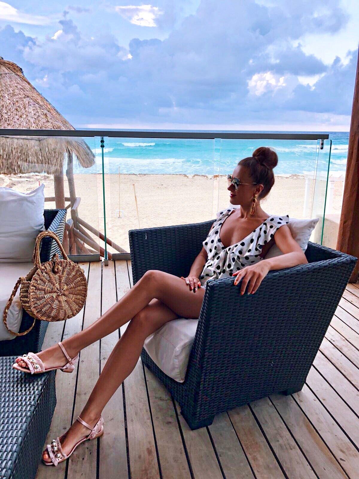 Elegant Duchess Fashion ASOS DESIGN Cut Out Ruffle Playsuit In Spot | Miu Miu sunglasses | South Beach Round Gold Woven Straw Cross Body Bag | Glamourous Pearl Sandals | ASOS DESIGN Wrapped Bead & Tassel Earrings