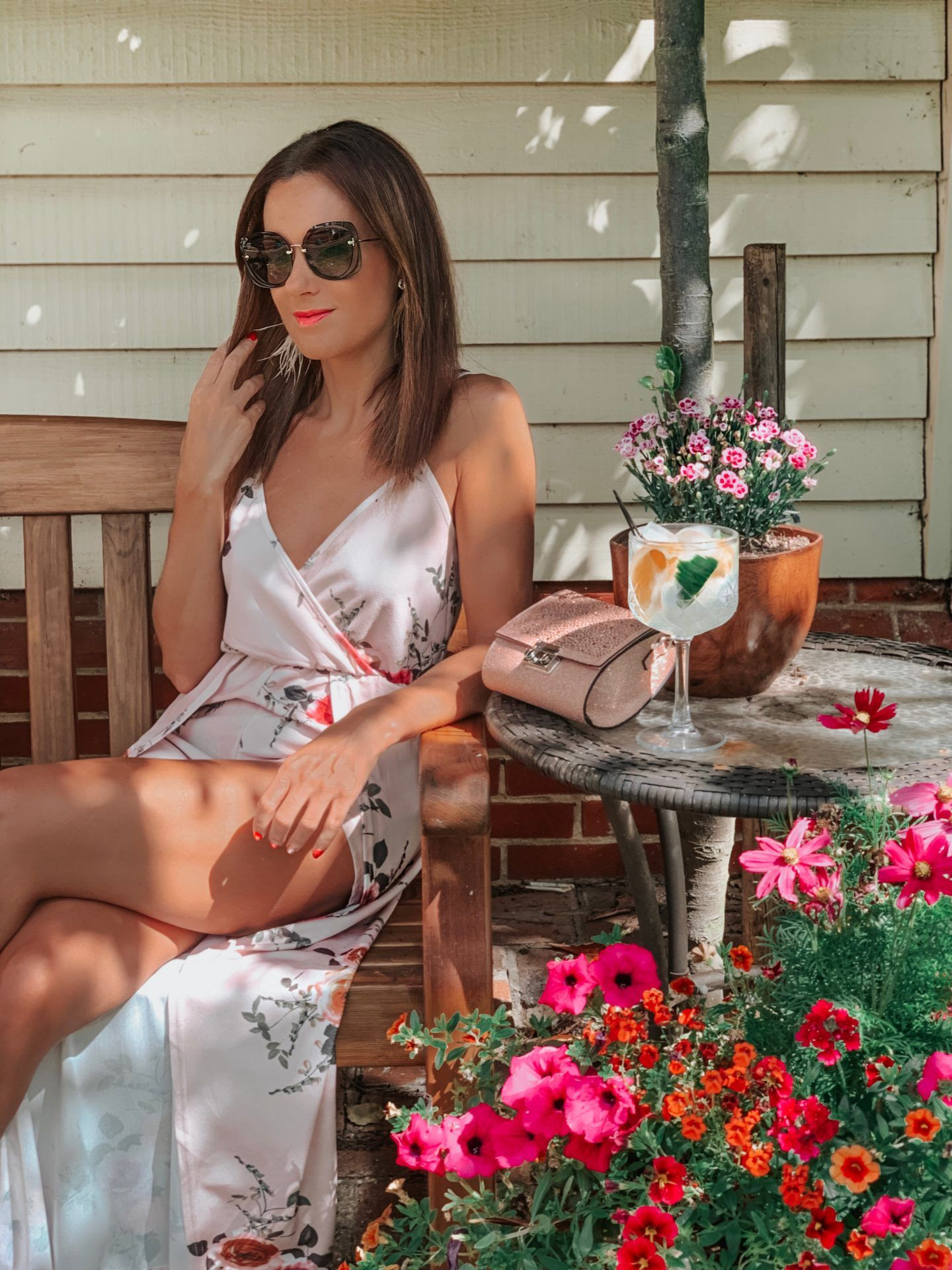 Elegant Duchess Boutique Sleeveless Flower Print Playsuit | Elegant Duchess Boutique Chic Heart shaped Straw Bag | Miu Miu sunglasses | New Look Crystal embellished clutch bag | Ted Baker Court Shoes