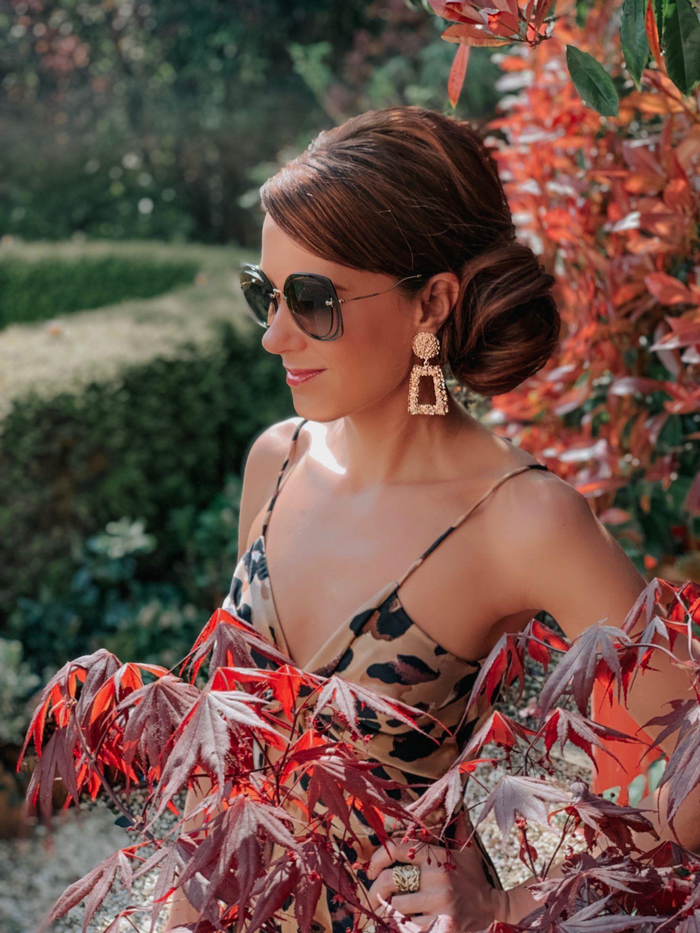 Forever Unique Leopard Print Wide-Leg Jumpsuit | Zara square earrings | Miu Miu sunglasses | Charlotte Tilbury make up | River Island Heels | Next Natural Square Shopper Bag