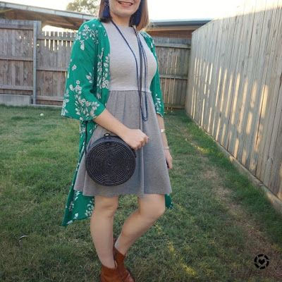awayfromtheblue Instagram | green floral duster with a skater dress and ankle boots straw circle crossbody bag
