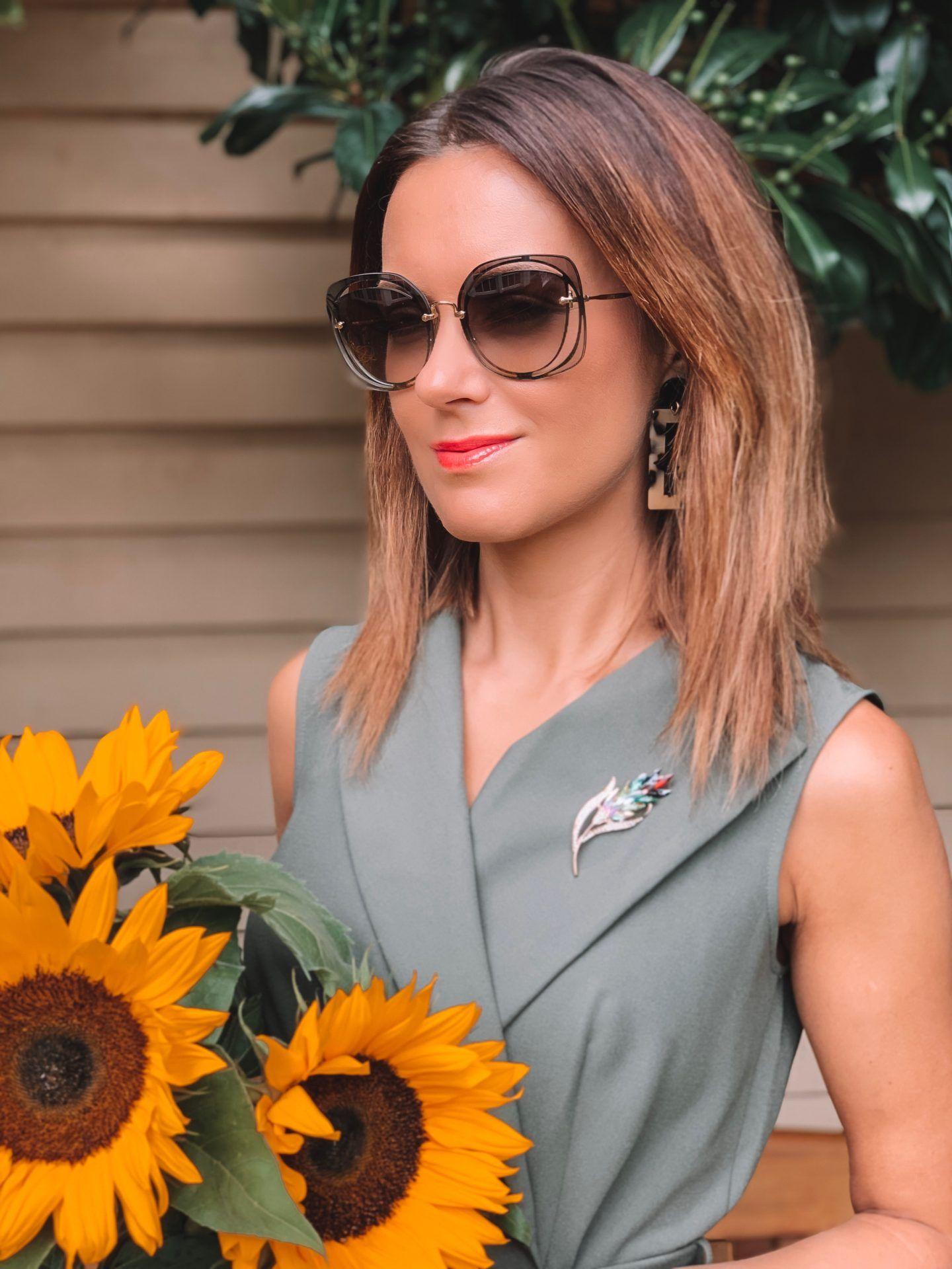 Closet London Khaki Collared Midi Pencil Dress | Elegant Duchess Boutique brooch | Miu Miu sunglasses | River Island Bag