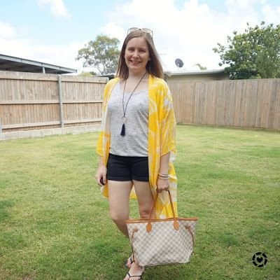 awayfromtheblue Instagram | Jeanswest Eliza summer poncho in yellow floral denim shorts tee beach picnic outfit