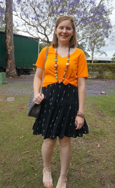 orange tee knotted over black printed tiered sundress with colourful accessories | awayfromblue
