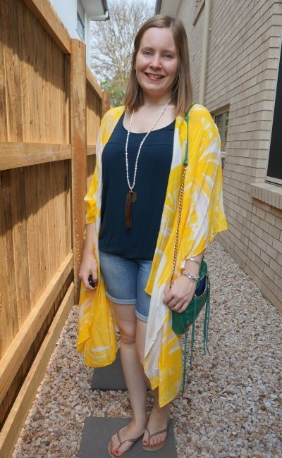 Jeanswest Eliza summer poncho in yellow floral kimono duster with navy tank and bermuda denim shorts   away from blue