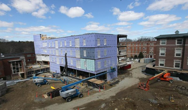 Regis College's renovations include an extension of Maria Hall (center), which will look onto a grassy quad that is replacing a parking lot.