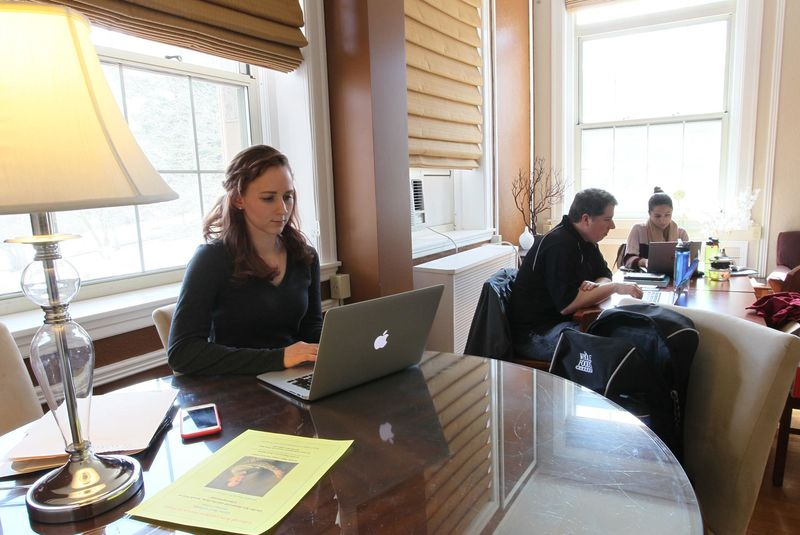 Graduate students sat in the lounge at College Hall.